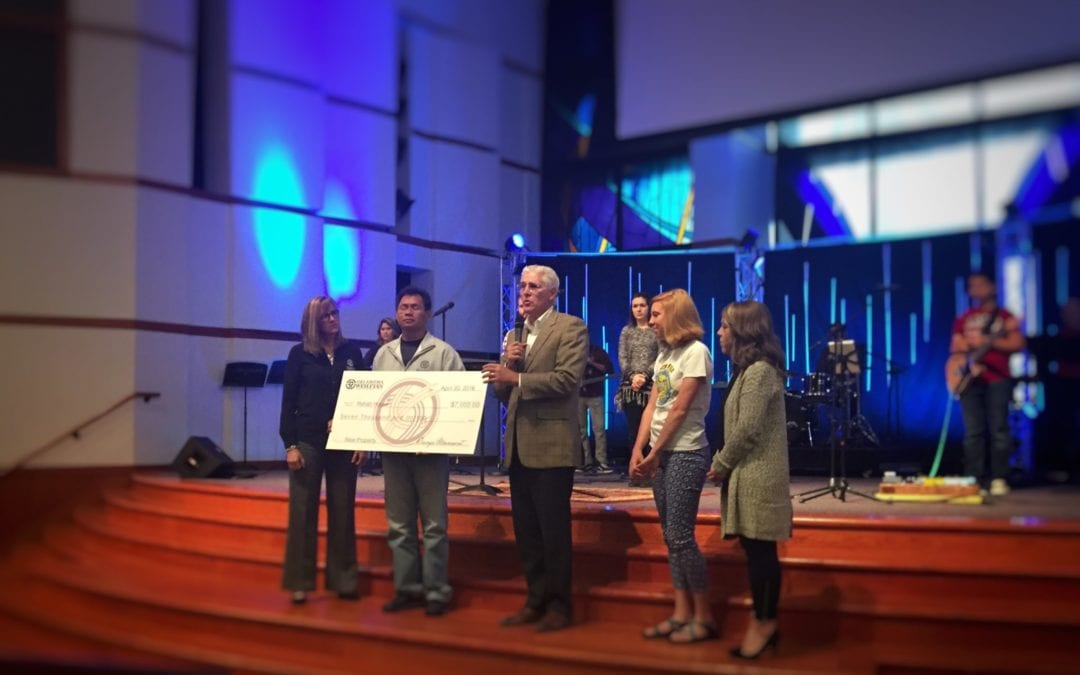 sunrise over river|||||pastor ed receives check for building