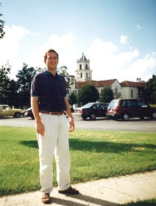 Student in front of mansion